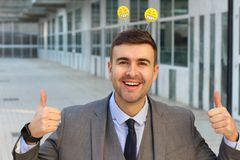 Businessman smiling with smiley headwear.  royalty free stock images