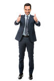 Businessman smiling with thumbs up Royalty Free Stock Images