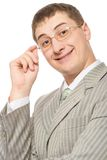 Businessman smiling and touching glasses Stock Photo