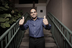 Businessman smiling with two thumbs up Stock Photography