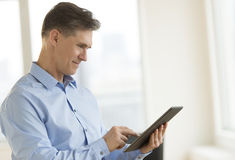 Businessman Smiling While Using Tablet Royalty Free Stock Photo