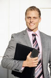Businessman Smiling With Folder Stock Photos