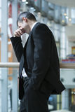 Businessman smirking and covering eyes Royalty Free Stock Photos