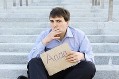 Businessman smokes Royalty Free Stock Images