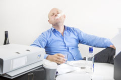 Businessman smokes and drinks at the office Royalty Free Stock Photography