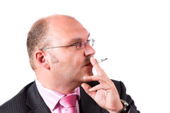 Businessman smoking Stock Image