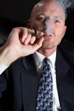 Businessman Smoking Stock Photography