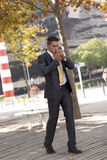 Businessman smoking Royalty Free Stock Photo