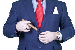 Businessman smoking cigar. Royalty Free Stock Photos