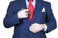 Businessman smoking cigar. Royalty Free Stock Photography
