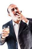 Businessman Smoking a cigar Royalty Free Stock Images