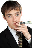 Businessman Is smoking dollar. Stock Photo