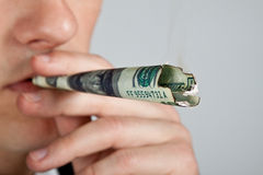 Businessman Is smoking dollar. Royalty Free Stock Photos