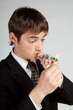Businessman Is smoking dollar. Stock Images