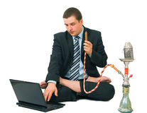 Businessman smoking hookah Royalty Free Stock Photos