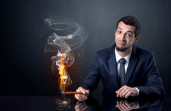 Businessman smoking. Royalty Free Stock Photography