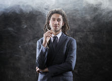 Businessman smoking a joint Stock Photos