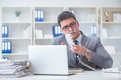 The businessman smoking in office at work. Businessman smoking in office at work Royalty Free Stock Photography