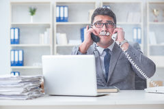 The businessman smoking in office at work. Businessman smoking in office at work Stock Image