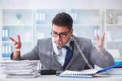 The businessman smoking in office at work Royalty Free Stock Photography