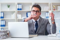 The businessman smoking in office at work. Businessman smoking in office at work Stock Photography
