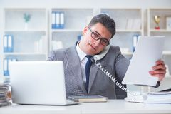 The businessman smoking in office at work. Businessman smoking in office at work Royalty Free Stock Images