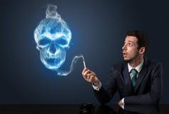 Businessman smoking. Businessman smoking with skull simbol above his head Royalty Free Stock Photography