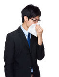Businessman sneeze Royalty Free Stock Image