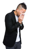 Businessman sneeze with painful face Stock Photo