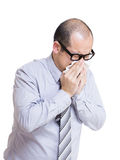 Businessman sneezes Stock Images