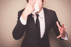 Businessman sneezing Stock Photos