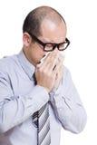 Businessman sneezing Stock Image