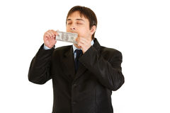 Businessman sniffing hundred dollar banknote Stock Photo