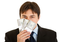 Businessman sniffing hundred dollar banknote Royalty Free Stock Photos