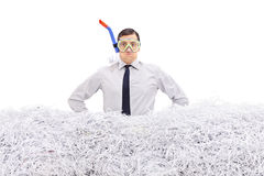 Businessman with snorkel standing in shredded paper stock images