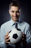 Businessman with soccer ball Royalty Free Stock Photo