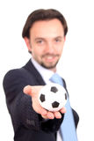 Businessman with a soccer ball balanced on finger Stock Images