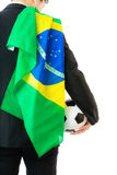 Businessman with soccer ball and brazil flag. Isolated on white stock images