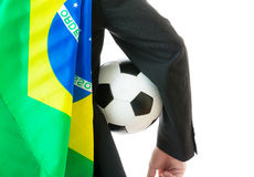 Businessman with soccer ball and brazil flag Stock Photos