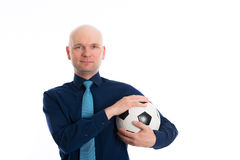 Businessman with soccer ball under his arm Royalty Free Stock Photo
