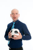 Businessman with soccer ball under his arm Stock Photo