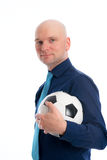Businessman with soccer ball under his arm Stock Photos
