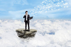 Businessman and social media above clouds Stock Photo