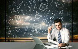 Businessman with social media symbols Stock Photography