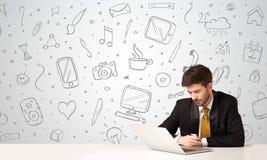 Businessman with social media symbols Royalty Free Stock Image