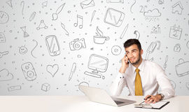 Businessman with social media symbols Stock Images