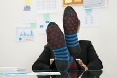 Businessman with socks in his feet Stock Photos