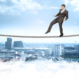 Businessman softly walking on rope Royalty Free Stock Photos