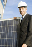 Businessman with solar panel Royalty Free Stock Photos