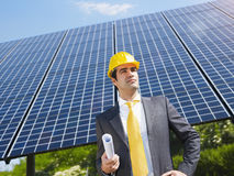 Businessman and solar panels Stock Photo